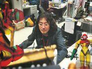 Page 22 of Nintendo's 2011 company guide with Sakamoto and Samus