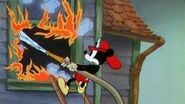 Mickey attempting to douse flames