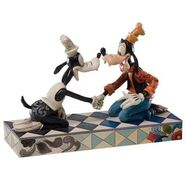 4026096-disney-traditions-goofy-through-the-years-goofy-figurine-4026096