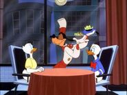 Goofy serving the ducks their dinner