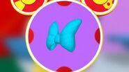 Blue ribbon mouseketool tied like a bow