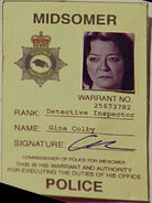 Gina-colby-warrant-card