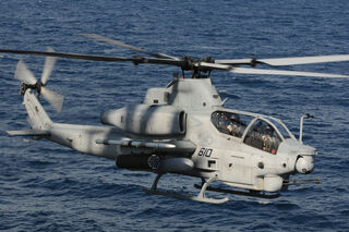 US Navy 100802-N-3852A-366 An AH-1Z Cobra helicopter assigned to Rotary Wing Aircraft Test Squadron (HX) 21, based in Patuxent River, Md., approaches the amphibious assault ship USS Wasp (LHD 1)