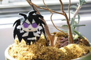 Chibi Pluto with Moss by fyre flye