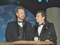 Dan and Swampy accept an award