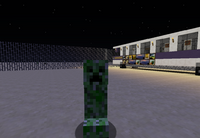 A Creeper Next to an Orion V Bus inside of Eastchester Depot