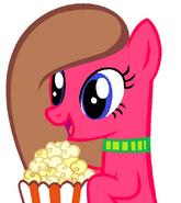 Melody Star comiendo palomitas