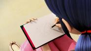 Mr. Pigeon Marinette dibujando en su libreta