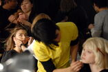 106246601-miranda-kerr-and-model-backstage-during-gettyimages