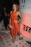 Miranda-Kerr-brightened-up-draped-orange-halter-dress-during