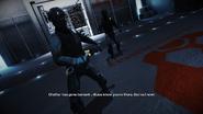 Pursuit cop holding a M26 Taser