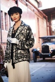 Miss-fisher-black-and-white-skirt-coat-339x500