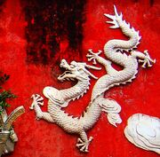 Dragon on a wall in Haikou - 01