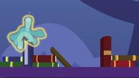 Blue teddy bear floats clumsily over bookshelf S7E3