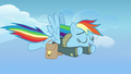 Rainbow Dash flying leisurely toward Ponyville S6E24.png