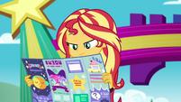 Sunset Shimmer looks at festival pamphlet EGSBP