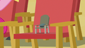 Boulder sitting in a tiny chair S7E4.png