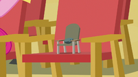 Boulder sitting in a tiny chair S7E4
