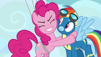 Pinkie Pie giving Rainbow a congratulatory hug S7E23