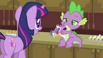 Spike playing with the figurines S2E25