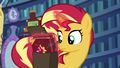 Sunset Shimmer puts her new journal in her bag EGS3.png