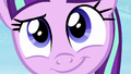 An extreme close-up of Starlight smiling S5E26.png
