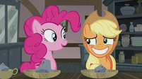 Applejack smiling nervously at Pinkie S5E20