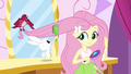 Fluttershy brushing her hair with her pets EG.png