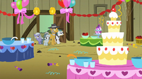 Pinkie Pie's family looking at the party decorations S1E23