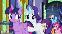 Rarity pushes Twilight out of the castle S9E26