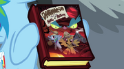 Rainbow Dash holding Daring Do book S04E04