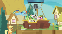 Rainbow Dash tosses cats into the balloon S8E5