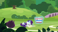 Rarity still sketching in her sketch book S8E17