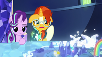Starlight and Sunburst look at Sire's Hollow on the map S8E8