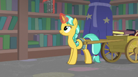 Unicorn student restacking the bookshelves S8E11