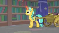 Unicorn student restacking the bookshelves S8E11