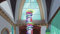 A book being levitated on top of a tower of books S5E26.png