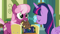 Cheerilee holds up another book; Twilight shakes her head S7E3.png