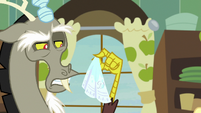 Discord holding handkerchief with disgust S8E10
