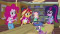 Pinkie, Sunset, and Twilight look at Fluttershy EG4.png