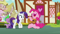 Pinkie bursts through the bakery door with guitar S7E9