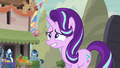 Starlight enters the village with a nervous grin S6E25.png