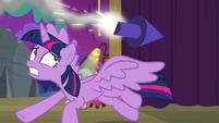 Twilight Sparkle dodging a flying rocket S8E7