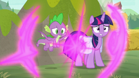 Twilight and Spike teleport behind a rock S9E5