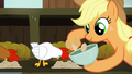 Applejack collects eggs while white chicken eats S6E10.png