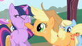 Applejack forcing Twilight to taste an apple S01E01.png