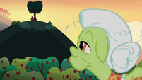 Granny Smith looks to Apple Bloom and Big Mac on the hill S5E17