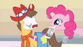 Pinkie Pie shows Applejack's picture to Caramel S1E14.png