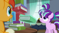 Filly Starlight levitates book out; looks up at book tower S5E26