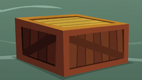 Wooden crate is placed on the ground S9E25